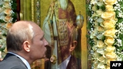 Russian President Vladimir Putin kisses an icon during a service and ceremony in Kyiv on July 27 to celebrate the 1,025th anniversary of Christianity in Ukraine and Russia.