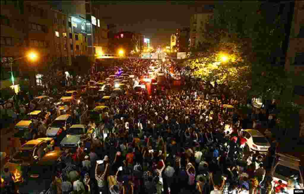 Thousands of Iranians poured onto the streets of the capital and other cities after the early evening announcement on June 15 that Rohani had won the vote and obviated the need for a second round.