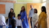 Britian's Prince William and Catherine, Duchess of Cambridge, visit a school classroom during a trip to Islamabad Pakistan on October 15.