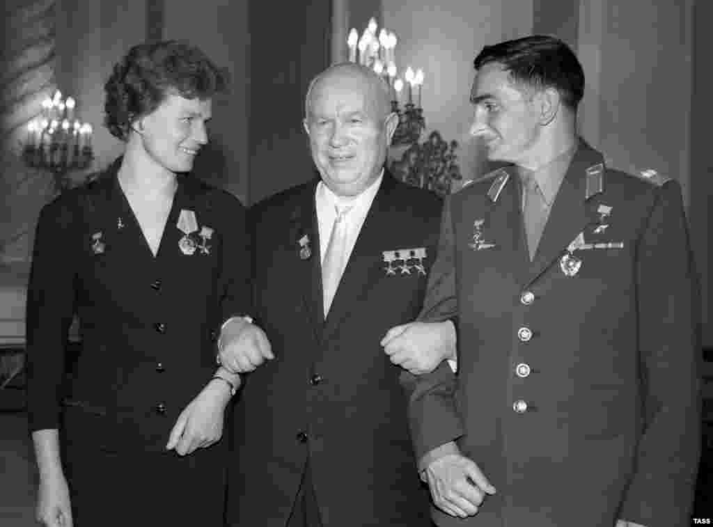 Soviet leader Nikita Khrushchev (center) with Tereshkova and cosmonaut Valery Bykovsky in 1963. Bykovsky holds the endurance record for a solo space flight. He spent five days in orbit.