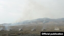 Nagorno-Karabakh - A column of Karabakh Armenian tanks on the move during a military exercise, 23Oct2012.