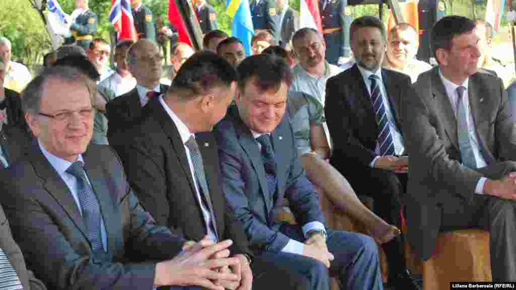 Minister of the Interior Dorin Recean (right) attends the ceremony.
