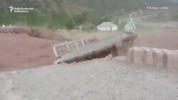 Dramatic Footage Of Deluge Sweeping Away Tajik Bridge