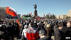 Pro-Russian demonstrators take part in a rally in front of a statue of Lenin in Kharkiv on March 8.