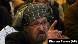 "Pakistani cleric Samiul Haq talks to reporters in Peshawar, Pakistan, Wednesday, Dec. 6, 2017. Haq, known as the ""Father of the Taliban,"" described Trump as an ""evil man"" and urged the Muslim world to stop the U.S. leader from insulting Palestinians."