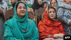 Kulsoom Nawaz (left) and Maryam Nawaz attend the election campaign meeting in Lahore in May 2013.