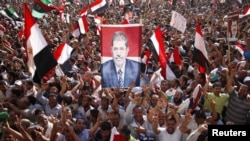 Thousands of Morsi supporters celebrate his victory in Tahrir Square.