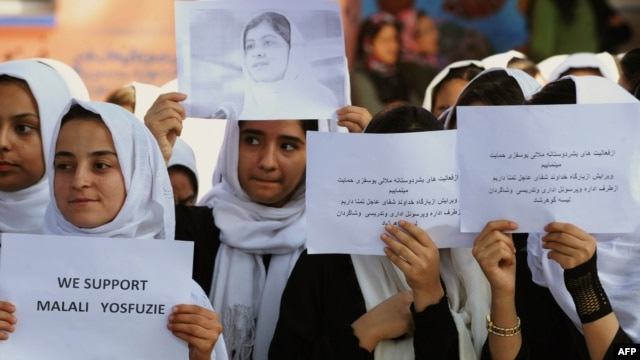 Afghan students in Herat pray for the early recovery of Pakistani child activist Malala Yousafzai, who was shot in the head in a Taliban assassination attempt, on October 13.