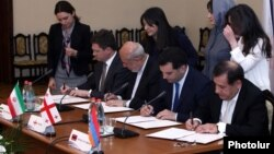 Armenia - The energy ministers of Russia, Iran and Armenia and a Georgian deputy energy minister sign an agreement in Yerevan, 13Apr2016.
