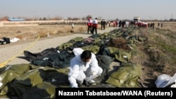 Passengers' bodies in plastic bags are pictured at the site where the Ukraine International Airlines plane crashed after take-off from Iran's Imam Khomeini airport, on the outskirts of Tehran, Iran January 8, 2020.