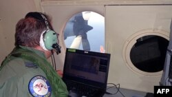 A crew member of an Australian maritime patrol aircraft involved in the search operation for Malaysian Airlines Flight MH370