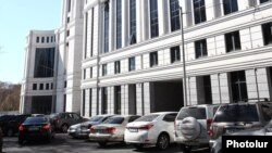 Armenia - Cars parked outside a new government building in Yerevan, 17May2016.