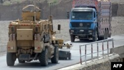 A U.S. mine-resistant ambush-protected (MRAP) vehicle patrols a highway leading to the border with Pakistan used for transporting goods in Afghanistan's Khost Province.