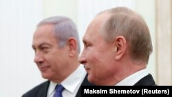 Russian President Vladimir Putin (right) meets with Israeli Prime Minister Benjamin Netanyahu at the Kremlin in Moscow on February 27.