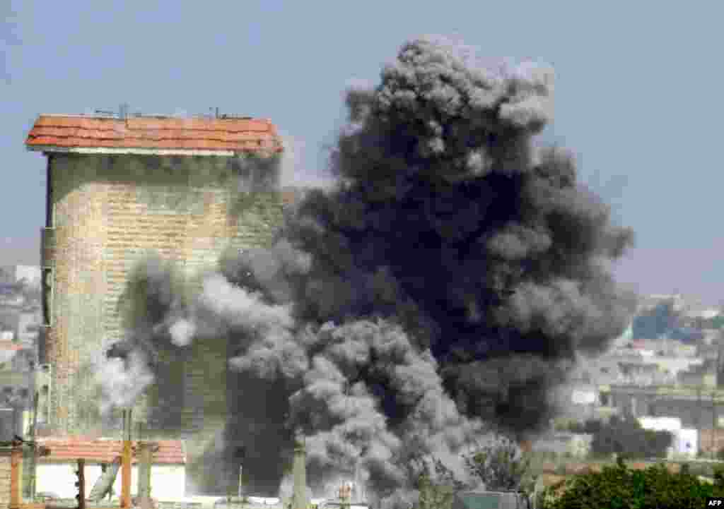 Suriyanın Homs şəhərində hakimiyyət nümayəndələriylə müxalif qüvvələr arasında qarşıdurma davam edir