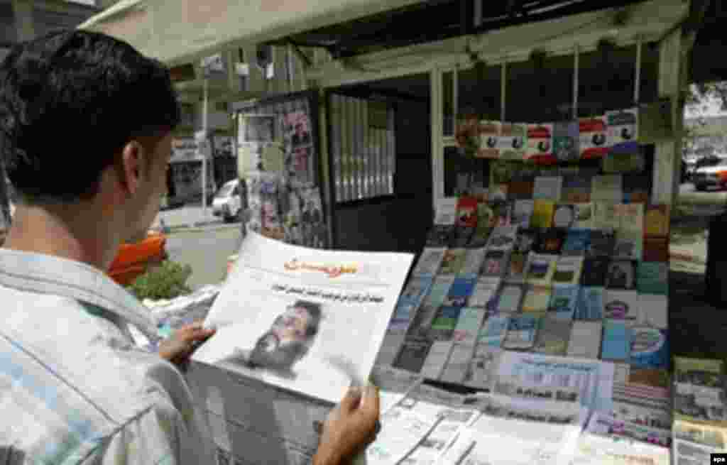A man in Baghdad reads on June 10, 2006, about the death of Al-Qaeda in Iraq head Abu Mu'sab al-Zarqawi (epa) - On June 8, 2006, Jordanian-born terrorist and Al-Qaeda in Iraq leader Abu Mu'sab al-Zarqawi was killed in a U.S. air strike north of Baghdad. Al-Zarqawi was responsible for numerous terrorist attacks in Iraq, as well as the simultaneous bombings of three hotels in Amman, Jordan, on November 9, 2005. More than 50 people were killed and more than 100 injured in those attacks.