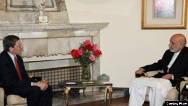 U.S. presidential envoy Marc Grossman (left) with Afghan President Hamid Karzai at a January 2012 meeting in Kabul