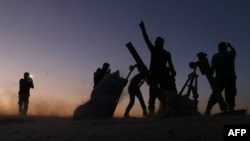 SYRIA -- Fighters from the Free Syrian Army cheer and react as they fight against the Islamic State (IS) group jihadists on the outskirts of the northern Syrian town of Dabiq, on October 15, 2016.