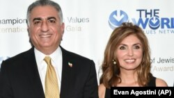 Reza (left) and Yasmine Pahlavi attend an awards gala in New York in May 2016.