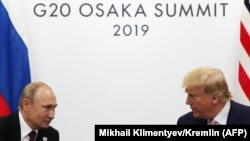 "U.S. President Donald Trump (right) said he and his Russian counterpart Vladimir Putin (left) ""talked a lot about arms control"" at the G20 summit in Japan."