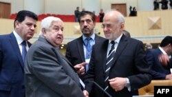 الجعفري خلال لقاء مع نظيره السوري وليد المعلم - طهران 9 كانون الأول 2014
