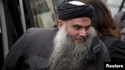 Radical Muslim cleric Abu Qatada arriving at his home in London after being released on bail in November 2012.