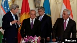 (L-R) U.S. Secretary of State John Kerry and foreign ministers Abdulaziz Kamilov of Uzbekistan, Erlan Abdyldaev of Kyrgyzstan and Erlan Idrissov of Kazakhstan arrive at the Central Asia Ministerial at the Department of State in Washington on August 3.
