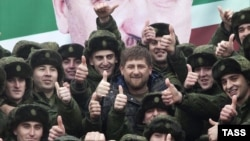 Is the Kremlin no longer ready to look the other way on transgressions by Chechen leader Ramzan Kadyrov's (center) entourage in Moscow?