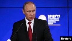 Russian President Vladimir Putin delivers a speech during the business session Russia-USA at the St. Petersburg International Economic Forum (SPIEF) on June 2.