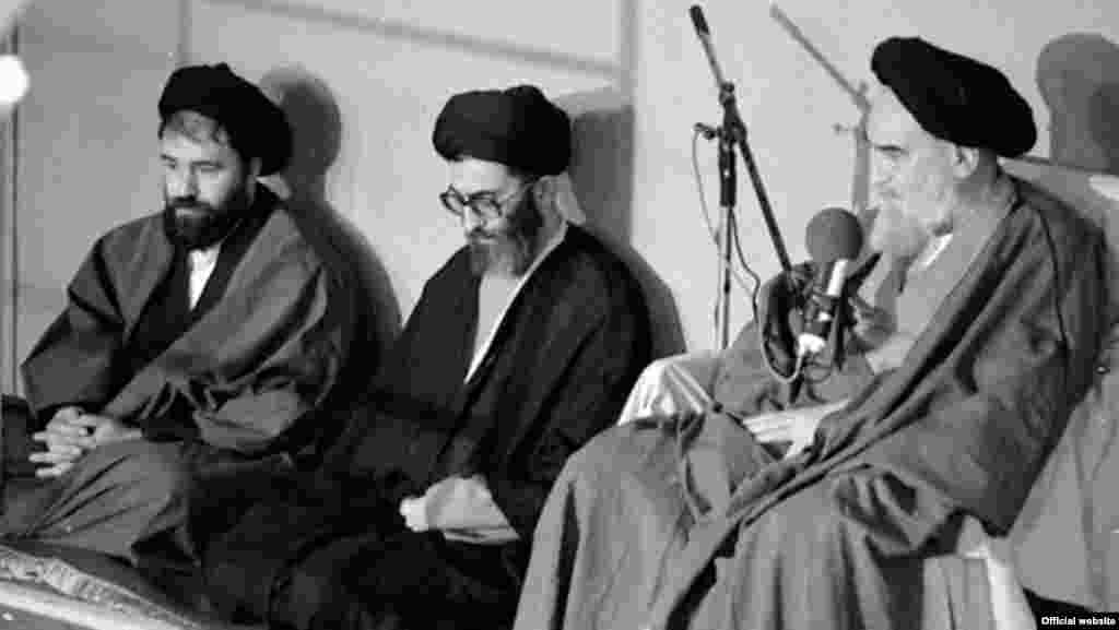 "Ayatollah Ruhollah Khomeini (right, with his eventual successor, Ali Khamenei, center) issued a fatwa on February 14, 1989, condemning Rushdie and all its editors and publishers to death and ""call[ing] on all valiant Muslims wherever they may be in the world to kill them without delay."""