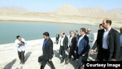Esagh Jahangiri, vice president of Iran visits a dam near Tehran, Sep20, 2014