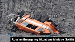 Police said the bus turned over and fell down a 10-meter drop near the town of Mezhdurechensk.