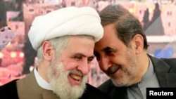 Ali Akbar Velayati (R), Iran's Supreme Leader Ayatollah Ali Khamenei's top advisor on international affairs, talks with Lebanon's Hezbollah deputy leader Sheikh Naim Qassem. File photo