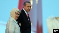 Turkish Prime Minister Recep Tayyip Erdogan and his wife, Emine, step off the plane upon their arrival in Tunis on June 5.