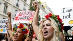 Activists from the Ukrainian women movement Femen protest against anti women's politic near the official Femen Centre opening today in Paris, 18Sep2012