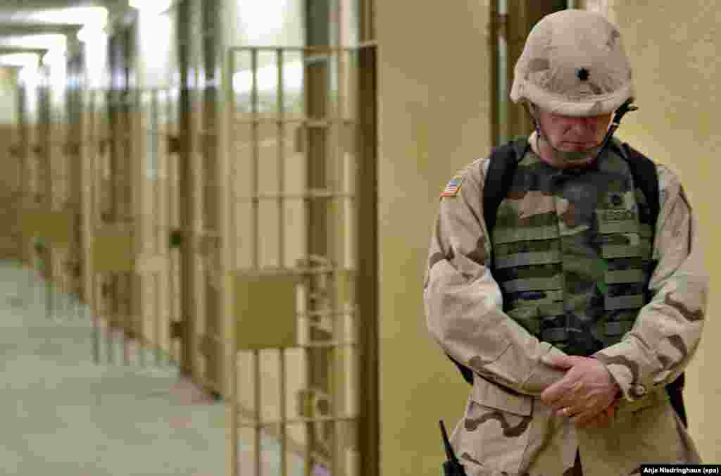 A U.S. soldier walks through the halls of the Abu Ghraib prison outside Baghdad, Iraq, on May 5, 2004.