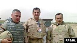 General Zaza Gogava (left) visiting Georgian troops in Iraq this summer