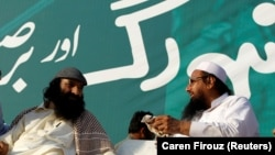 FILE: Syed Salahuddin (L), leader of the United Jihad Council, speaks with Hafiz Muhammad Saeed, chief of the banned Islamic charity Jamat-ud-Dawa, during a protest in Islamabad, Pakistan.