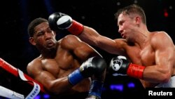Gennady Golovkin throws a right-hand punch against Daniel Jacobs.