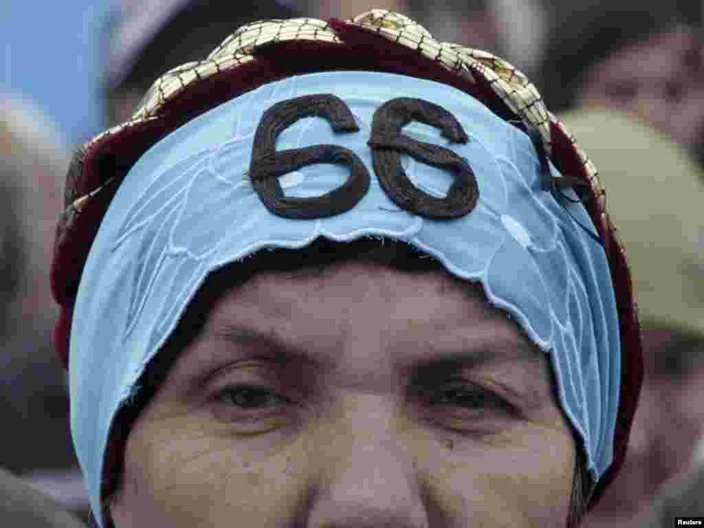 A Crimean Tatar attends a ceremony in Simferopol, Ukraine, marking the 66th anniversary of the deportation of Tatars from the peninsula to distant parts of the Soviet Union. Photo by Reuters