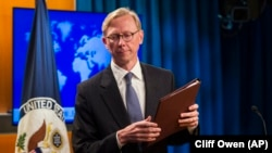 Brian Hook, special representative for Iran, leaves the podium after speaking about the creation of the Iran Action Group at the State Department, in Washington, Thursday, Aug. 16, 2018.