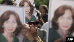 A rally in honor of slain Russian human rights activist Natalya Estemirova in Moscow in 2009
