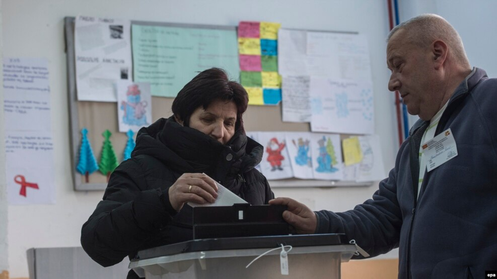 A voter casts a ballot on December 25 in the election rerun that was held in the Macedonian village of Tearce.