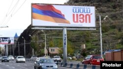 A billboard in Yerevan urges Armenians to vote for controversial constitutional amendments.