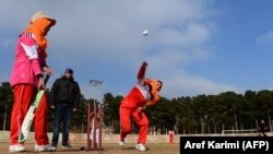 Afghan women play cricket at the grounds of the stadium in the western city of Herat in 2015.