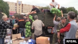 Ukrainian soldiers deliver food to residents of Slovyansk one day after liberating the city from pro-Russian separatists.