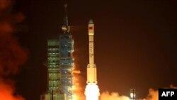 Қытай ғарыш кемесінің ұшу сәті. Ганьсу провинциясы, 29 қыркүйек 2011 жыл.
