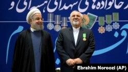 Хасан Роухани (слева) и Мохаммад Джавад Зариф