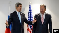 Switzerland -- US Secretary of State John Kerry (L) and Russian Foreign Minister Sergei Lavrov gesture prior to a bilateral on the side line of an OSCE ministerial meeting in Basel, December 4, 2014