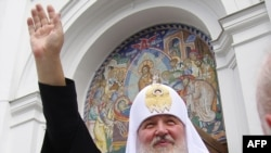 Patriarch of Moscow and All Russia Kirill waves during his visit to Odesa on July 20.